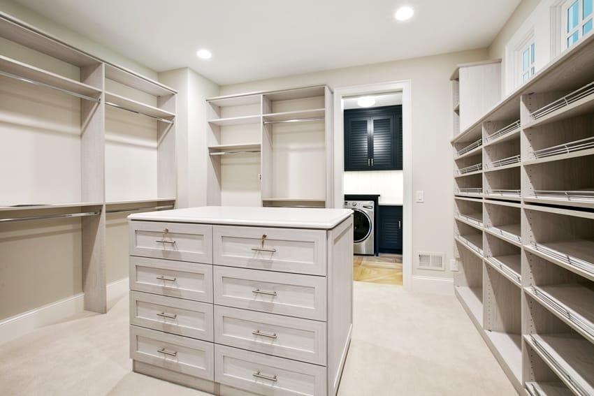 spacious walk in closet with an island dresser