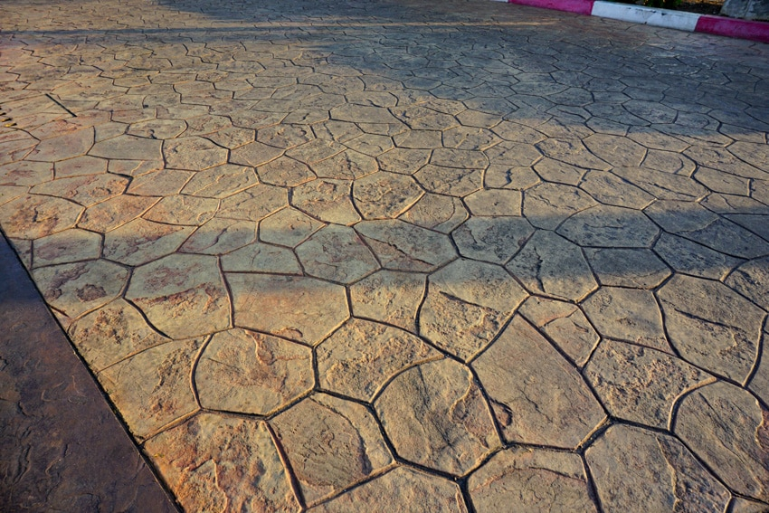 Stained concrete driveway with stone pattern