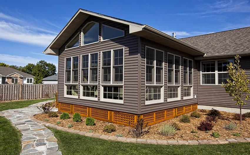 Sunroom addition built on house with lattice design
