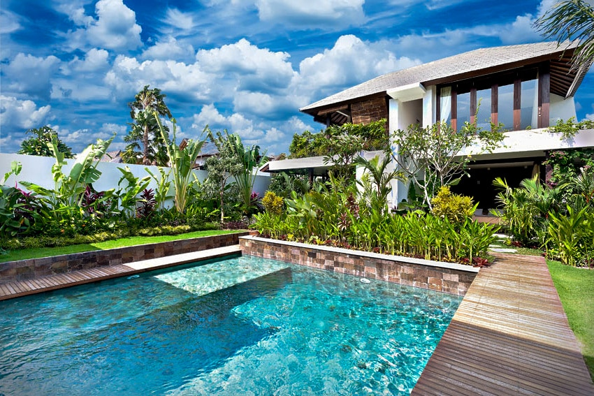 swimming pool with sitting platform and wood deck