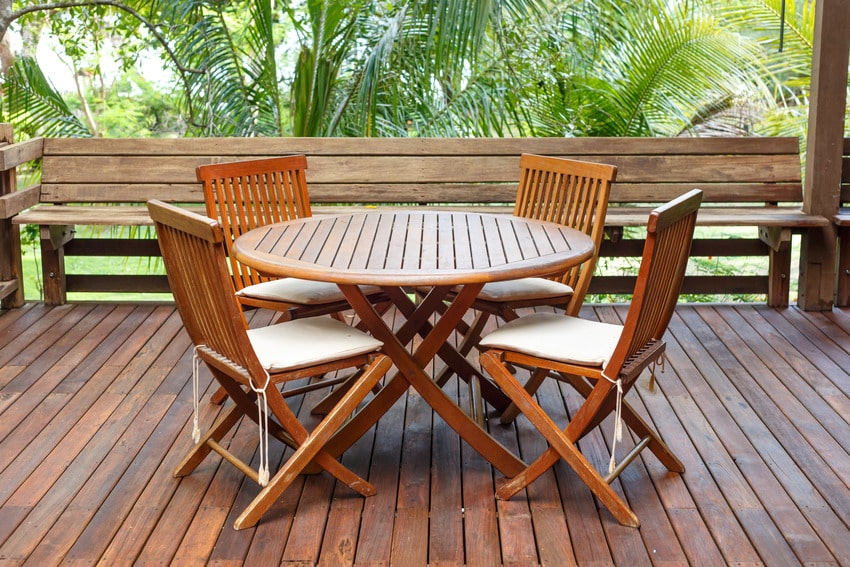 Teak outdoor dining table and chairs