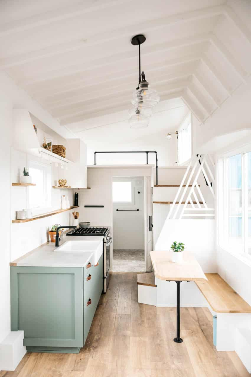 Tiny kitchen with booth sink and shelves