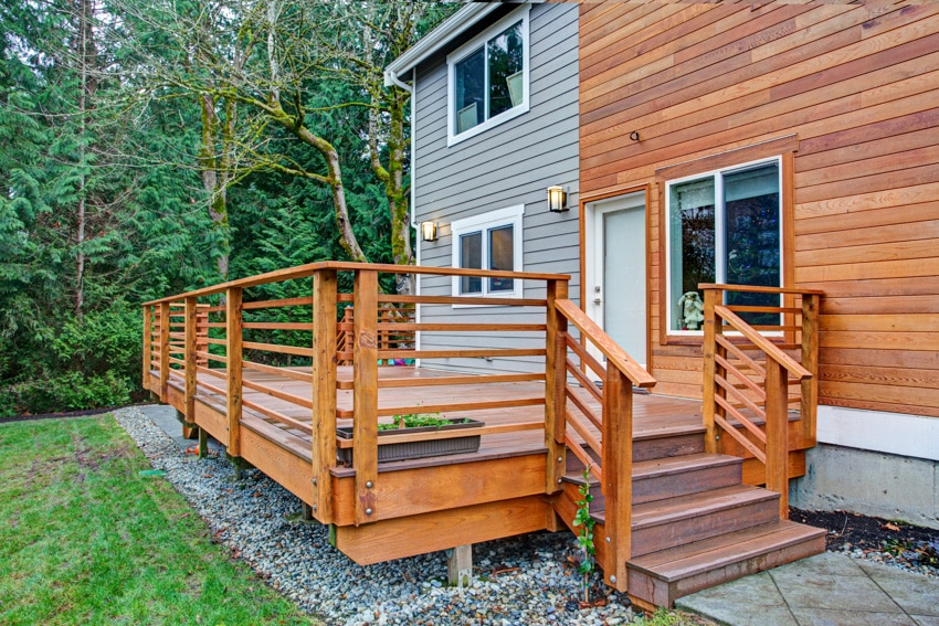Two storey house with cedar siding and wood deck