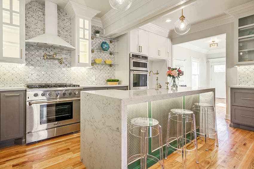 Unique kitchen island with quartz waterfall countertop under counter lighting geometric design on sides