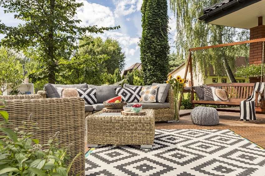 villa patio with comfortable rattan furniture and pattern carpet