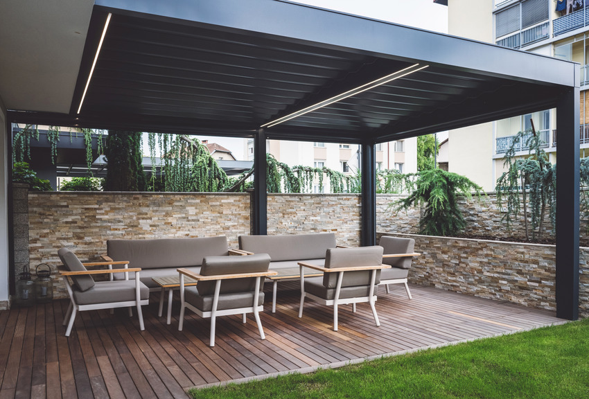 Vinyl covered patio with furniture and wooden flooring
