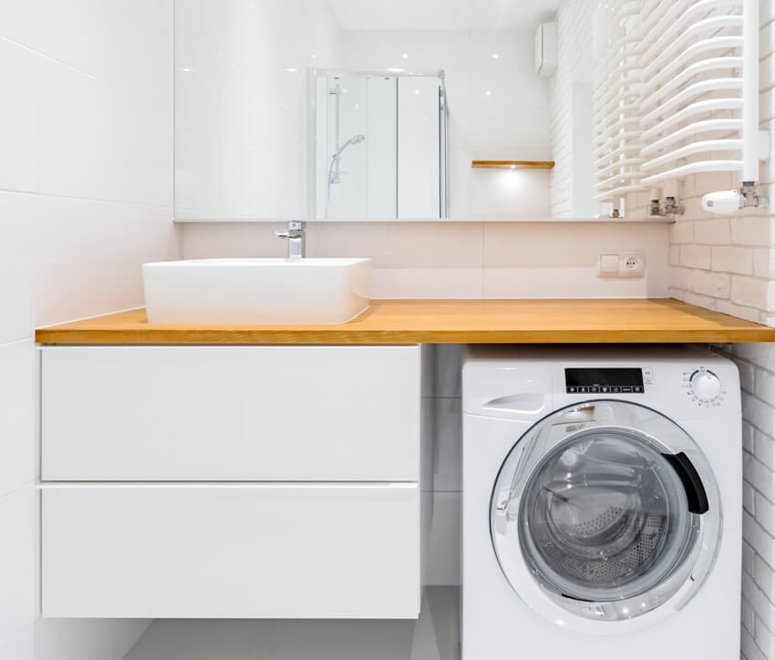 White bathroom with countertop basin mirror and washer