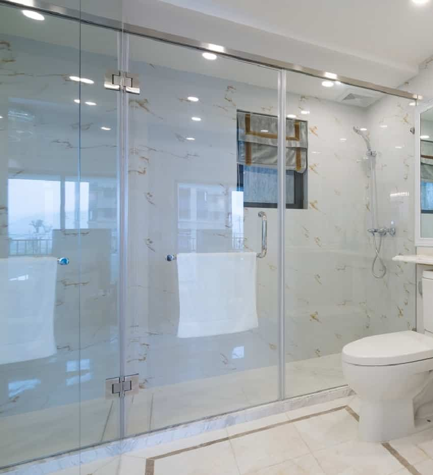 White interior bathroom with clear shower glass door