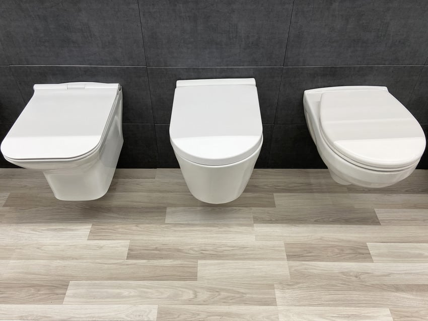 White tankless toilets in the showroom