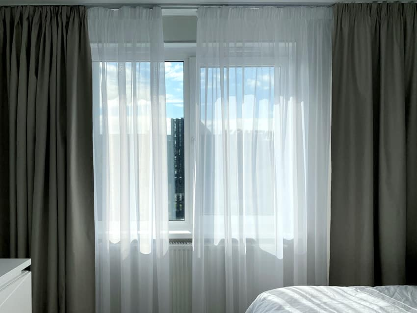 window with blackout curtain inside the room on a sunny summer day