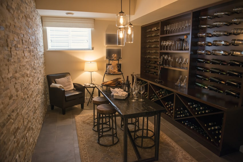 Wine closet room with sofa chair and table