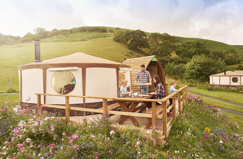 Yurt adu with wood deck picnic table