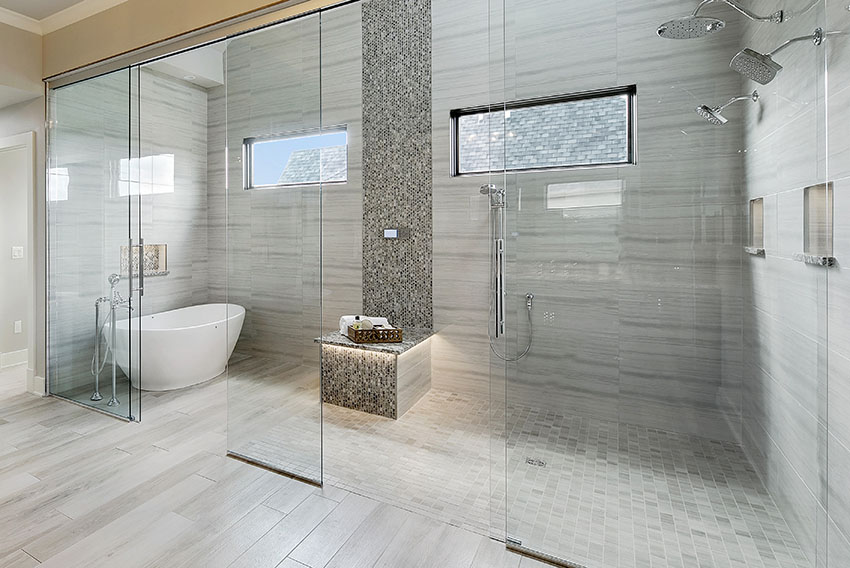 Bathroom shower with frameless shower doors free standing tub is