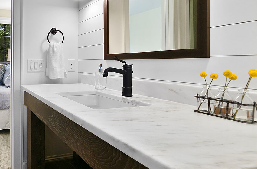 Bathroom sink with single handle faucet marble countertop is