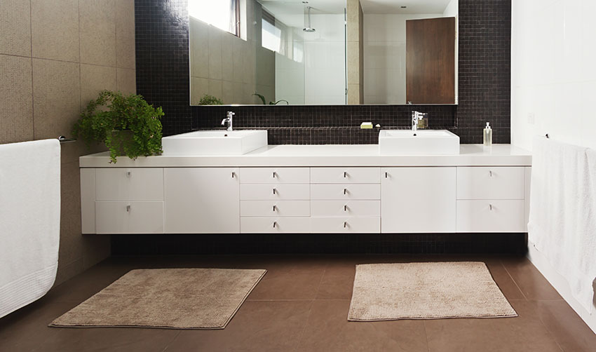 Double basin white vanity with rug large mirror is