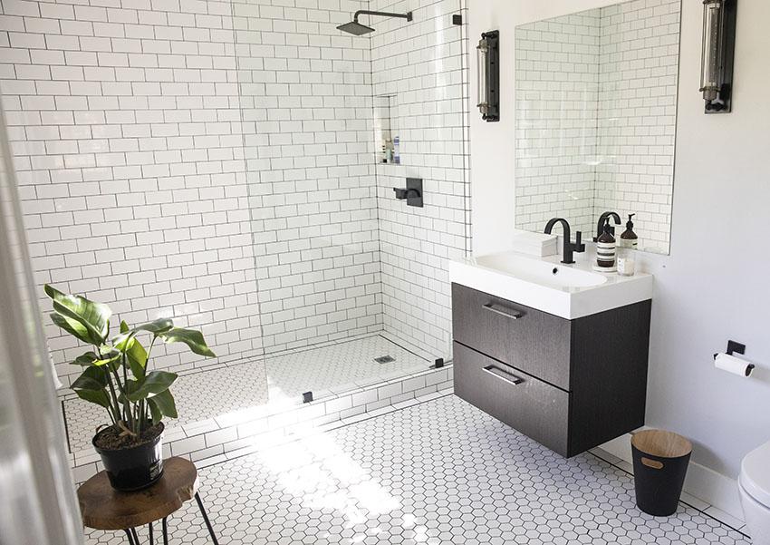 Bathroom with frameless glass shower door single sink vanity is