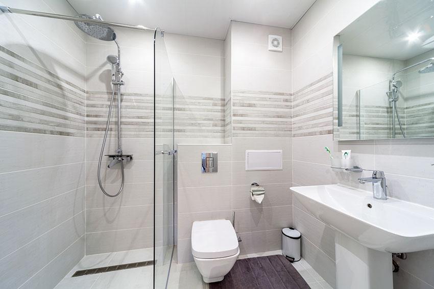 Bathroom with frameless shower door with pedestal sink
