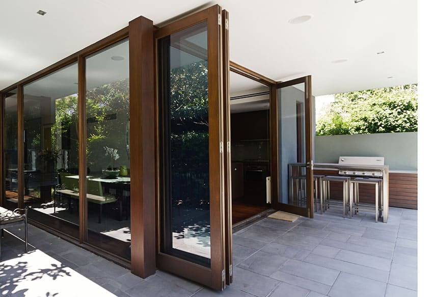 Big bi-fold doors with wooden frame picture window