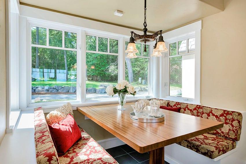 Breakfast nook with picture windows chandelier