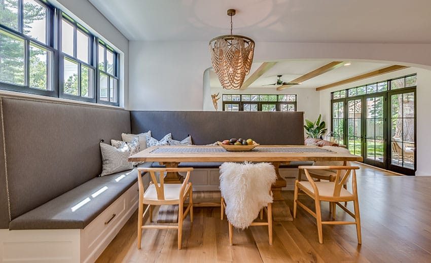 Breakfast nook with wood floor french doors chandelier