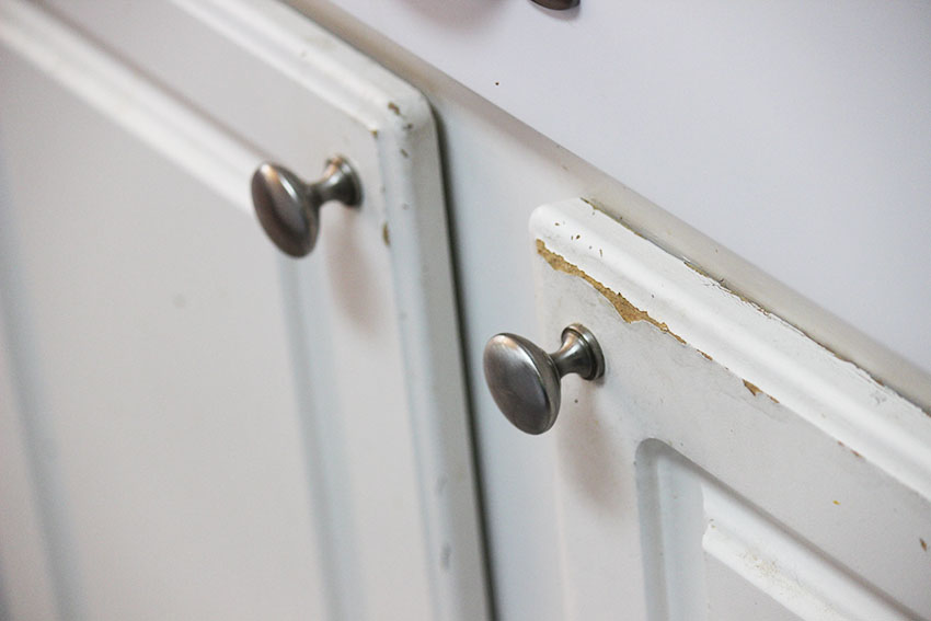 Cabinet door with worn spot and mushroom pull