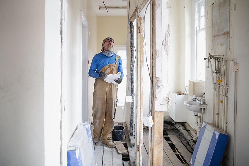 Contractor doing bathroom renovation is