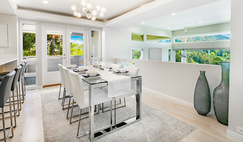 Dining room with glass table rug cove ceiling french door and windows white paint ss