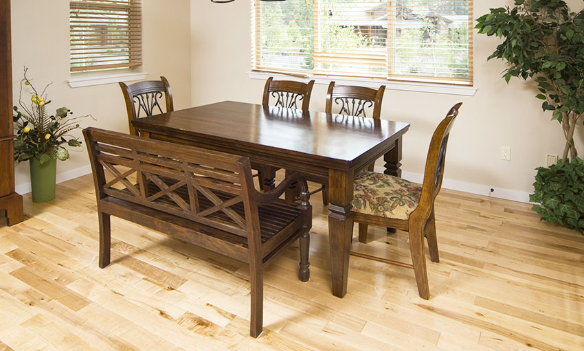 Dining table with wooden bench and chairs and window blinds