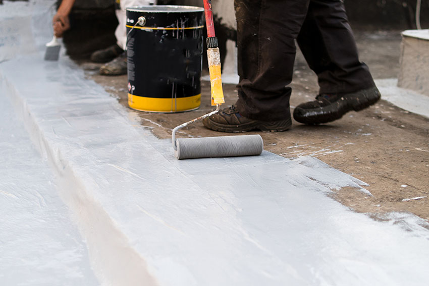 Applying silicone roof coating using roller brush