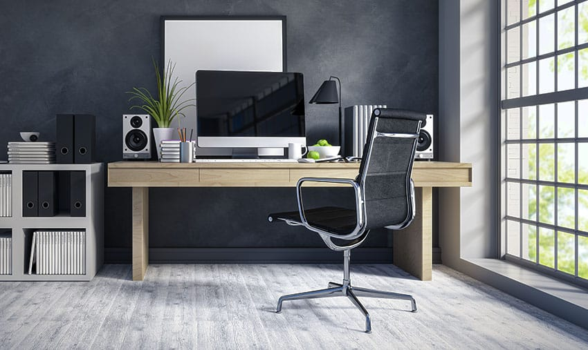 Home office desk with black wall lamp shade is