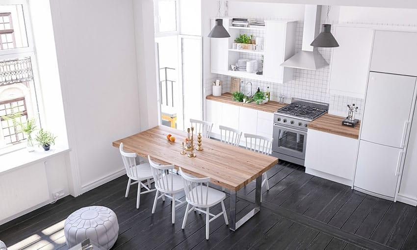 Kitchen and dining with white paint black wooden floor range hood white fridge