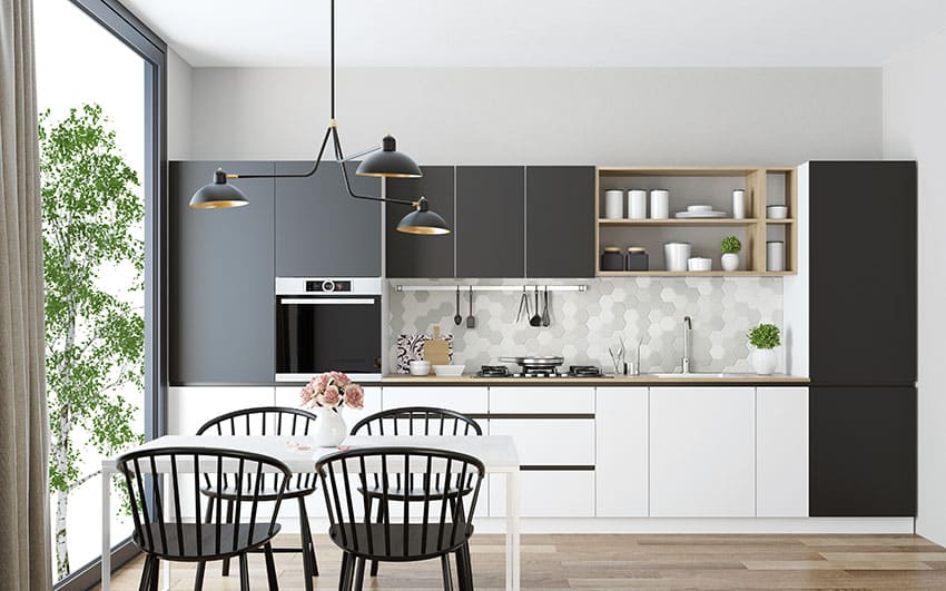 Kitchen and dining with black and white cabinets sputnik chandelier microwave