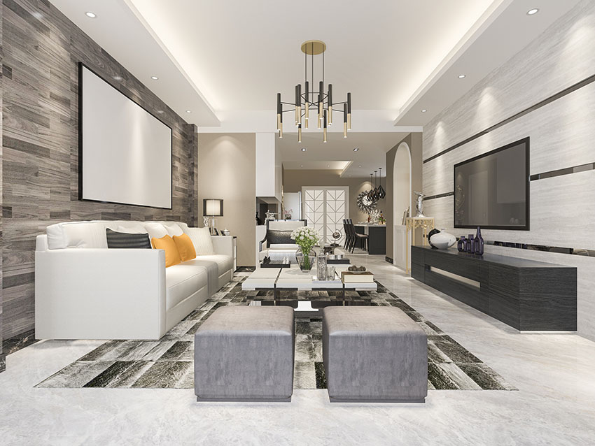 Living room with flat rug big white sofa black media cabinet cove ceiling modern chandelier is