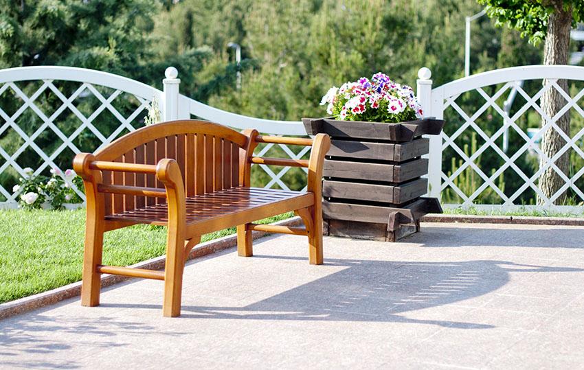Outdoor wooden bench in deck