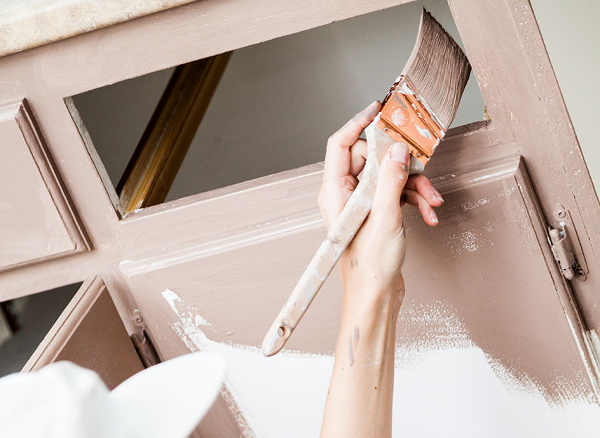 Painting cabinet using paint brush