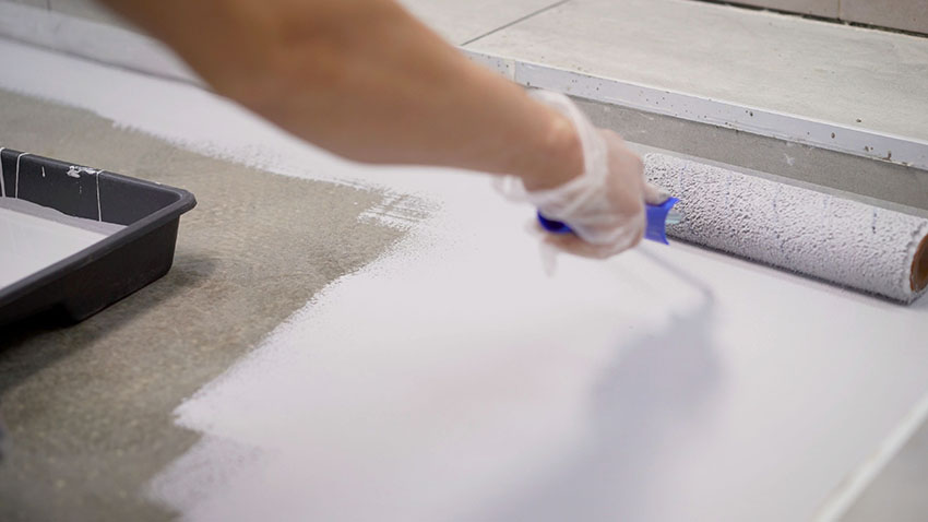 Painting flooring with roller brush