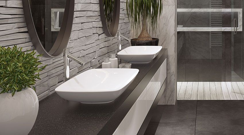 Vessel bathroom sink with single handle faucet black granite countertop stone wall cladding is