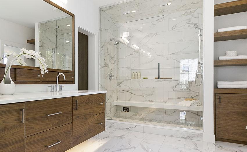 Walk in shower with white tiles frameless glass shower doors