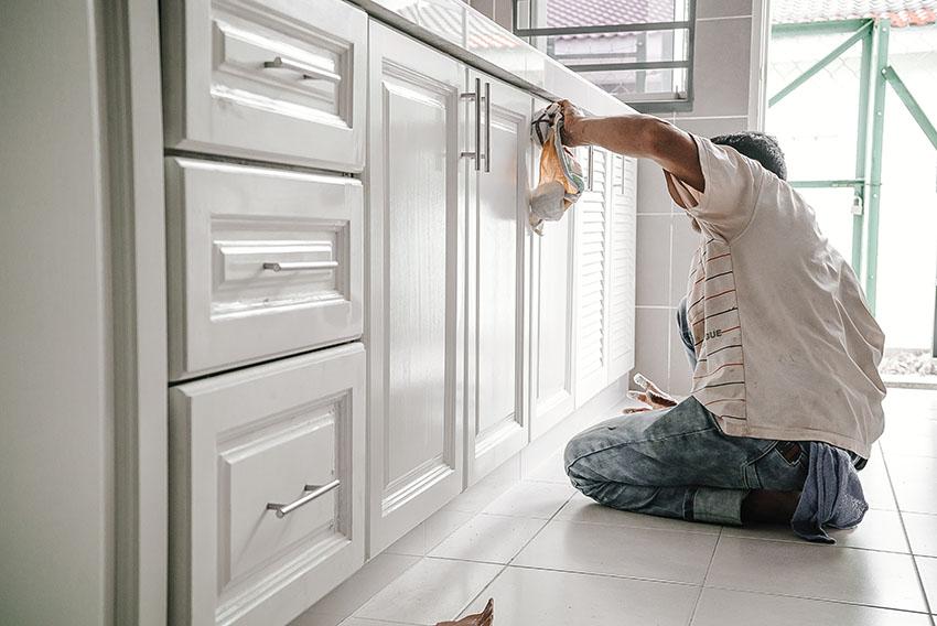 White kitchen cabinet repair