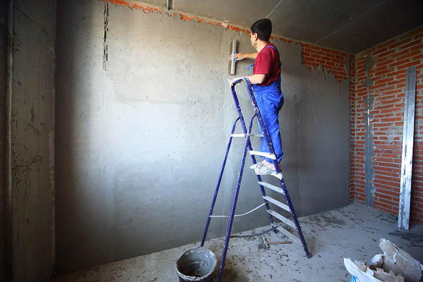 Adding stucco over brick walls