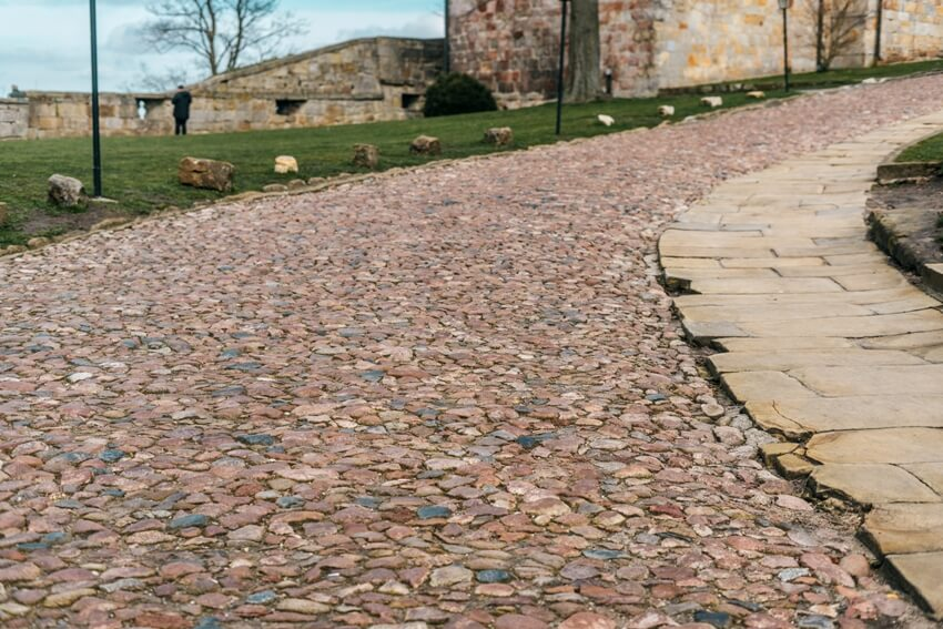 Ancient colorful paving stone along the walkway path