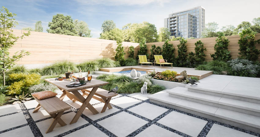 Backyard with concrete area wood table and chairs pool