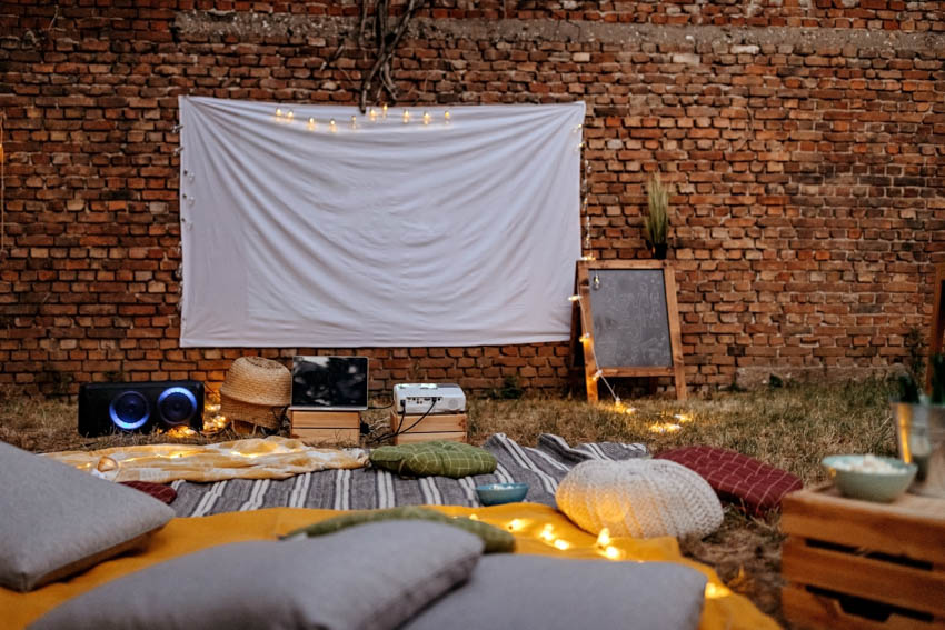 Backyard with projector screen pillows outdoor movie