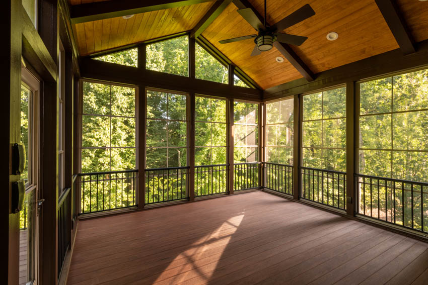 Bare porch turned into room wood floor ceiling windows