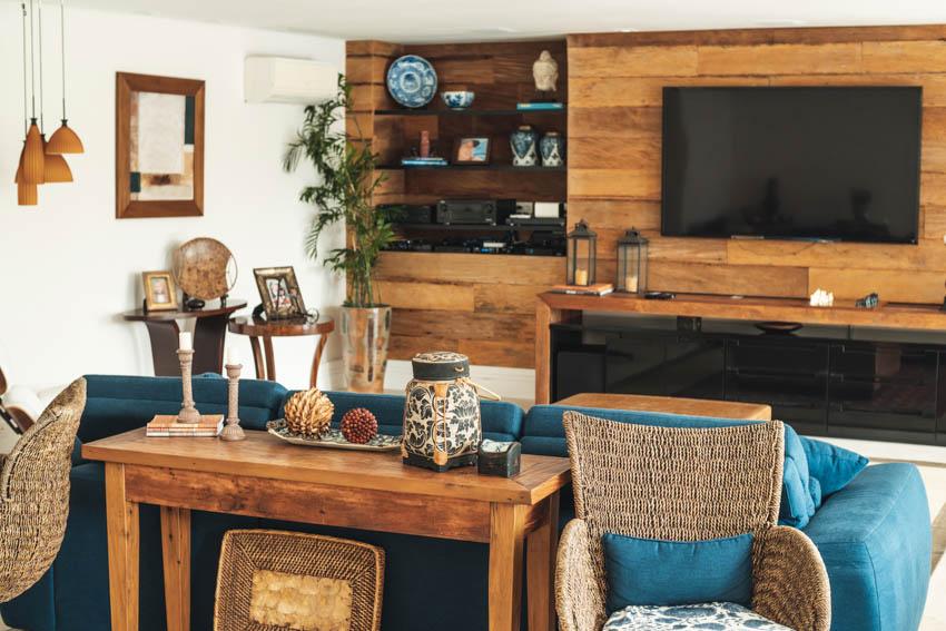 Barnwood living room blue sofa appliances white wall shelves indoor plant