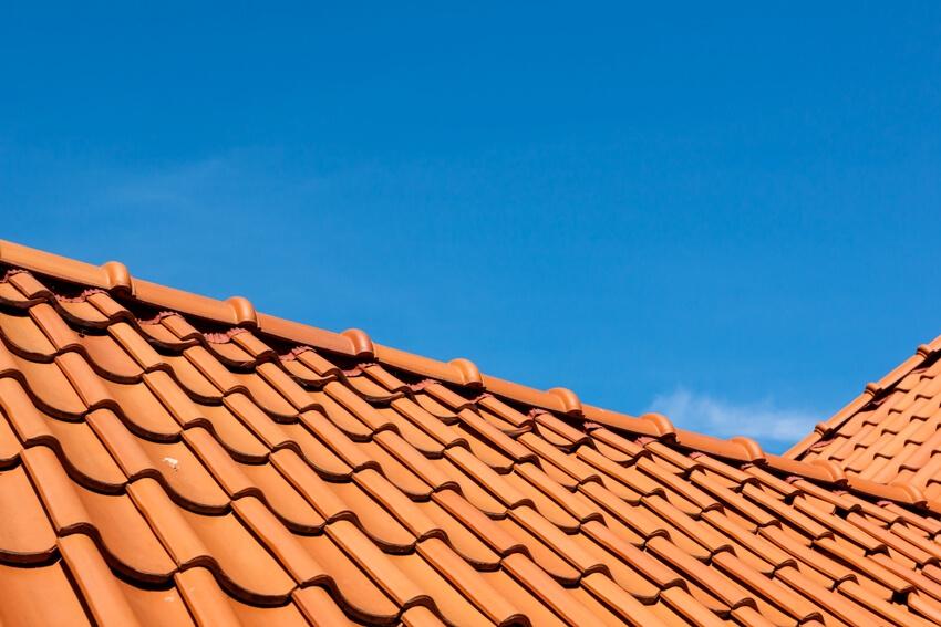 Barrel roof tile pattern over blue sky