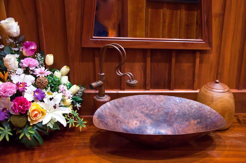 Basin sink made of copper wood countertop bathroom