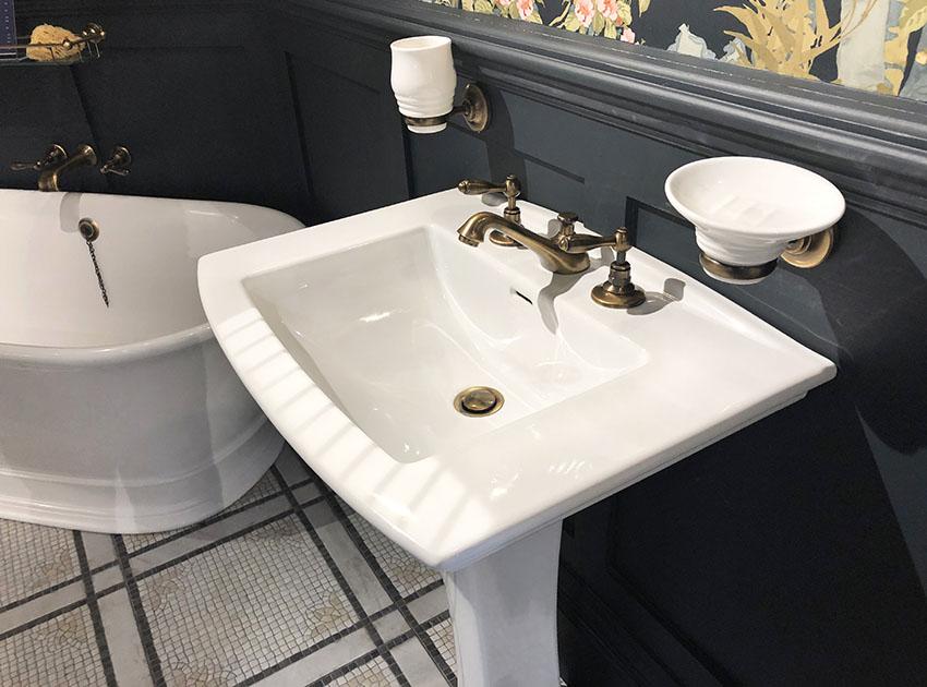 Bathroom pedestal sink black wainscoting