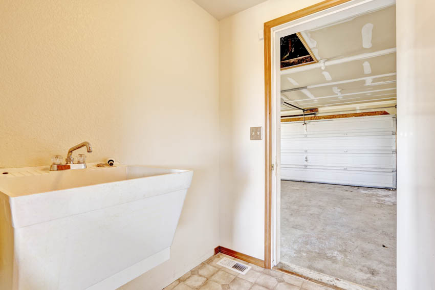 Bathroom sink leading to garage