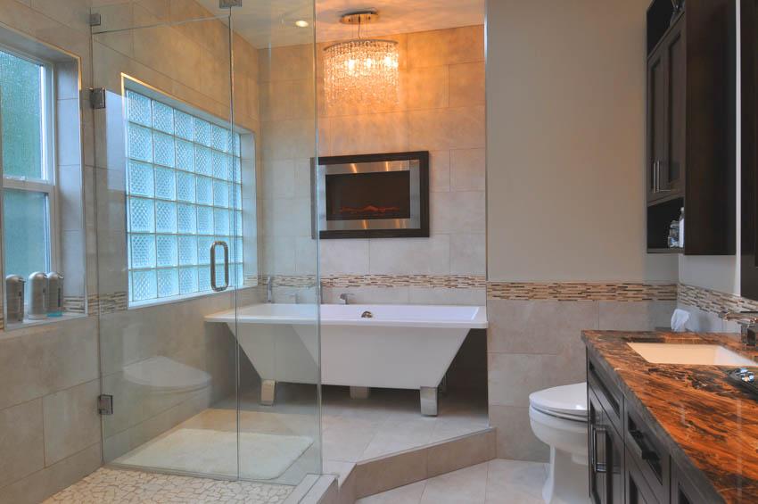 Bathroom with obscure glass window raised platform bathtub countertop glass door